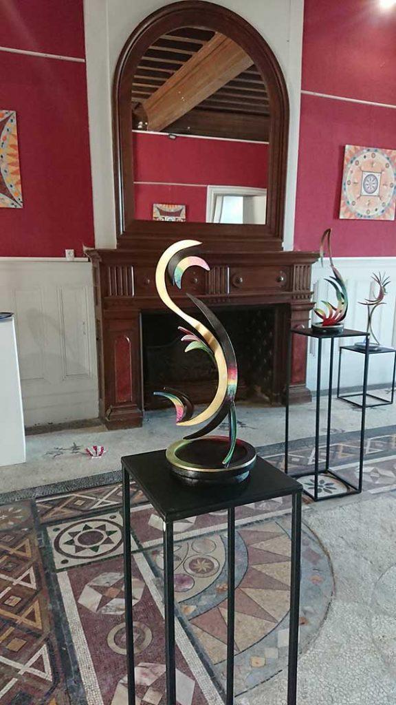 Sculpture Bronze patiné socle bois pivotant